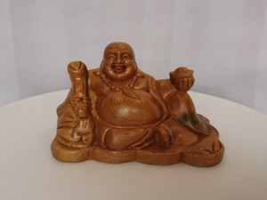 Phật Di Lặc ngồi cầm gậy như ý gỗ bách xanh 15cm x 9cm x 9cm